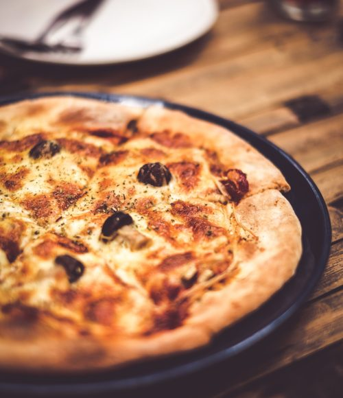 Laat de naam je niet foppen: eatmosfera pizza in Amsterdam Oost is super leuk en lekker